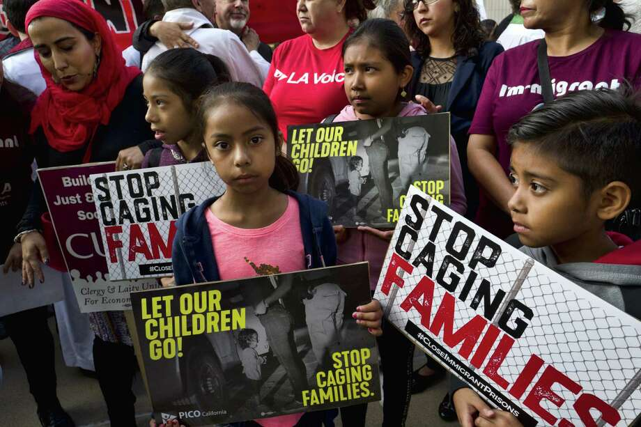 """Children attend a rally in front of federal courthouse in Los Angeles on Tuesday. The president's reversal on family separation is an indication that he fears he has gone too far with his """"evil immigrant"""" strategy. Photo: Richard Vogel /Associated Press / Copyright 2018 The Associated Press. All rights reserved."""