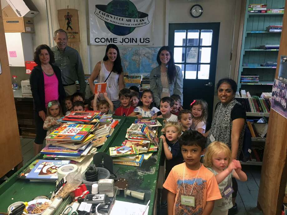 The preschool class at Noroton Presbyterian Child Care recently visited Darien Book Aid to make a book donation and learn more about the all-volunteer organization. Photo: Contributed Photo