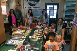 The preschool class at Noroton Presbyterian Child Care recently visited Darien Book Aid to make a book donation and learn more about the all-volunteer organization.