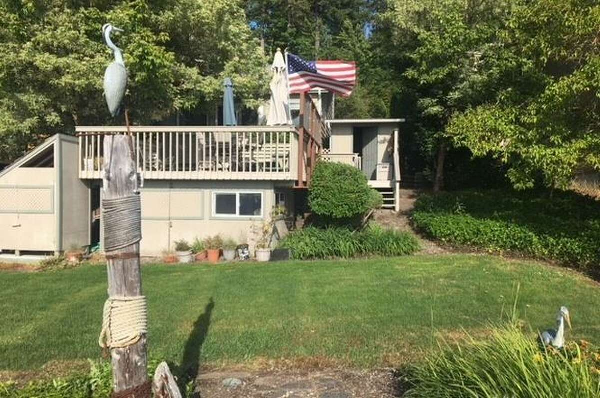 3450 E State Route 302, Belfair, WA 98528 listed for$399,500. See full listing below.