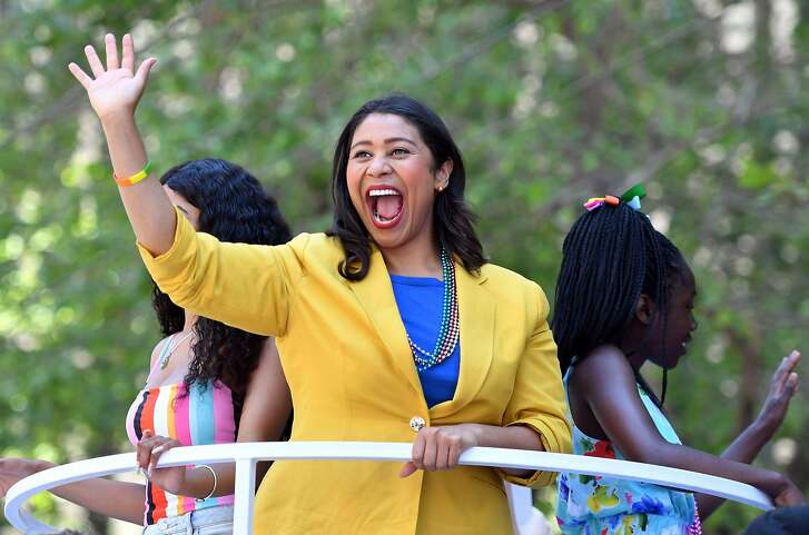 San Francisco Mayor London Breed waves to a cheering crowd atop a float during the San Francisco gay pride parade in San Francisco, California on June, 24, 2018. / AFP PHOTO / Josh EdelsonJOSH EDELSON/AFP/Getty Images