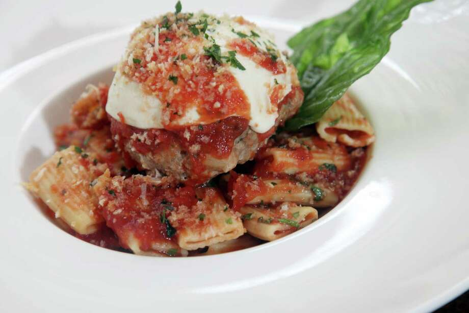 A giant meatball served on a bed of pasta was featured on the menu at Zocca Cuisine D'Italia on in 2012. Photo: Express-News File Photo / San Antonio Express-News