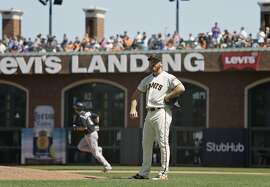 San Francisco Giants relief pitcher Sam Dyson stands on the mound after giving up a two-run home run to the Colorado Rockies' DJ LeMahieu in the ninth inning of a baseball game Thursday, June 28, 2018, in San Francisco. Colorado won the game 9-8. (AP Photo/Eric Risberg)