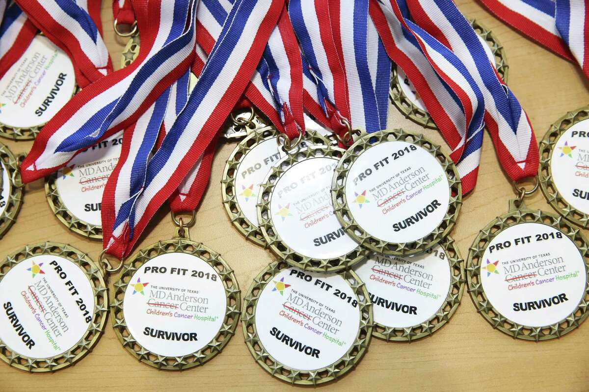 Medals are prepared for patients and family members who play sports with Olympian long jumper Yvonne Treviño Hayek, of Mexico, in a ?