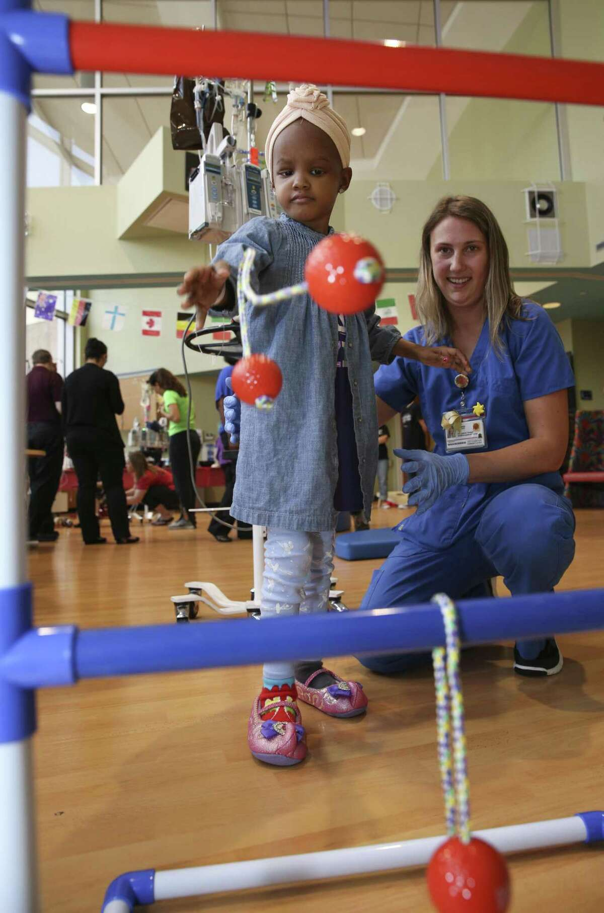 Lauryn Criswell, 5, plays an obstable game with MD Anderson Occupational Therapist Janet Dempsey at MD Anderson on Thursday, June 28, 2018, in Houston. The ?