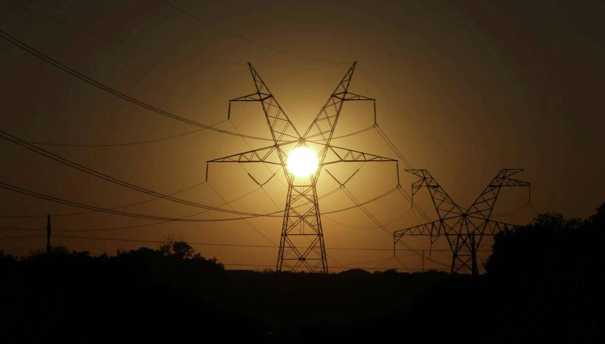 The sun sets on electrical power lines in Grand Prairie.