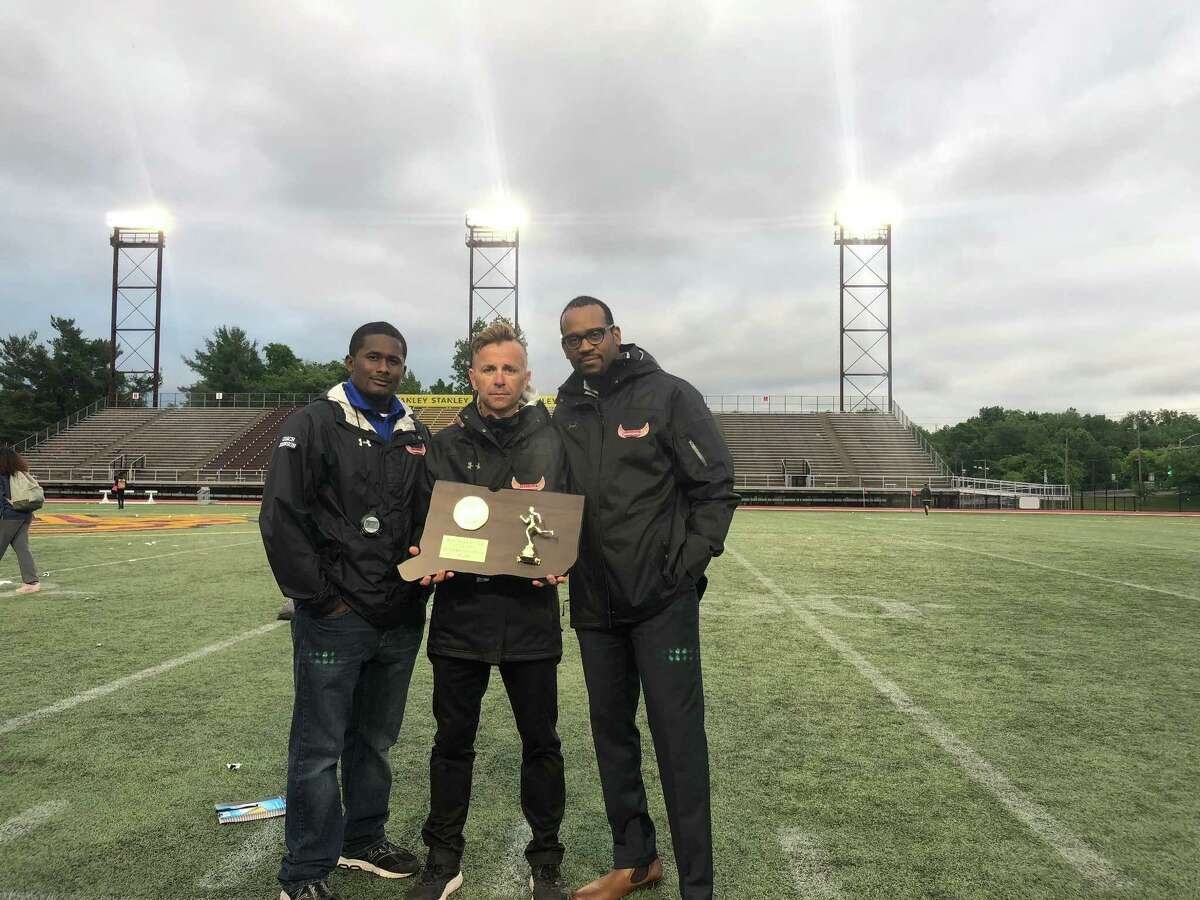Danbury cross country and track coach Rob Murray, center, has led the Hatters to more than 600 wins and 35 FCIAC championships in his almost 20 years as coach.