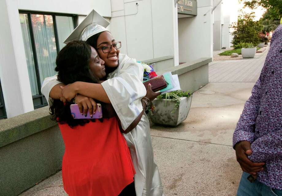 Graduate Shanyce Thomas gets a hug from her mom Gina after Capitol Prep Harbor School's 3rd Annual Commencement Ceremony at the Holiday Inn in downtown Bridgeport, Conn., on Thursday June 28, 2018. Photo: Christian Abraham, Hearst Connecticut Media / Connecticut Post