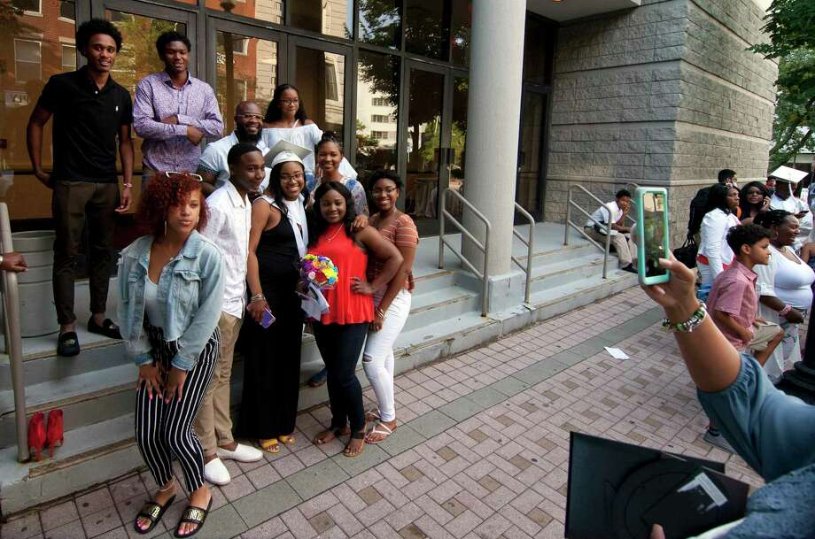Relatives pose for photos with graduate Shanyce Thomas after Capitol Prep Harbor School's 3rd Annual Commencement Ceremony at the Holiday Inn in downtown Bridgeport, Conn., on Thursday June 28, 2018. Photo: Christian Abraham, Hearst Connecticut Media / Connecticut Post