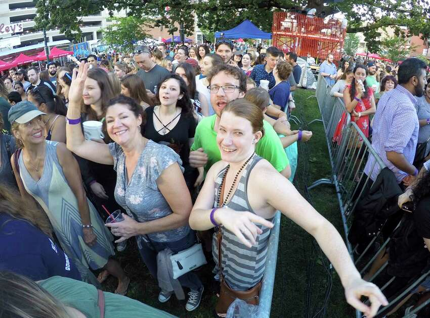 Dina Cashman of Milford dances to the music as she waits with friends for the performance of Gavin DeGraw at the Alive@Five concert series in Columbus Park on June 28, 2018 in Stamford, Connecticut.