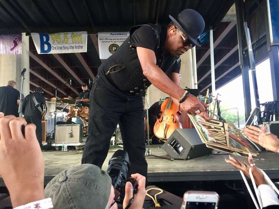 Tito Jackson signs a record for a fan at Albany's Alive at Five concert on June 28, 2018, after his set with the B.B. King's Blues Band wrapped. (Bethany Bump / Times Union) Photo: Bethany Bump / Times Union
