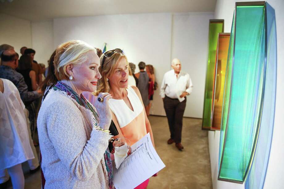 """People look at artist Claire Ankenman's """"Ideal Dream"""" sculptures at a reception for the artist at Moody Gallery in Houston. A group of major art dealers have joined together to form the Houston Art Gallery Association to promote the city as a destination for art collectors. Photo: Michael Ciaglo, Houston Chronicle / Houston Chronicle / Michael Ciaglo"""
