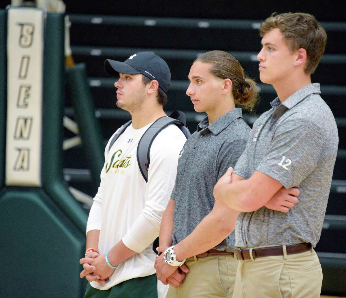 Siena lacrosse players from left, Dylan Pantalone Anthony Tebbano and Maurice Tessier listen as their new coach Liam Gleason is introduced during a news conference Thursday June 28, 2018 in Colonie, NY. (John Carl D'Annibale/Times Union)