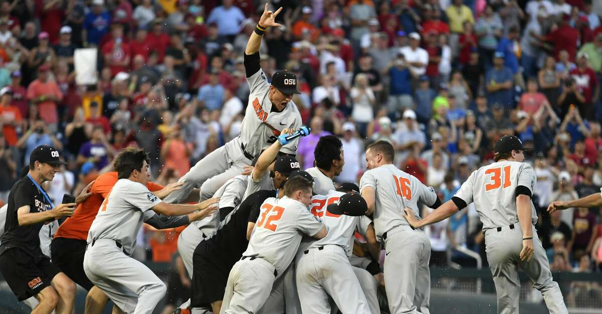 Oregon State players celebrate after winning Game 3 of the NCAA College World Series baseball finals in Omaha, Neb., Thursday, June 28, 2018. Oregon State defeated Arkansas 5-0. (AP Photo/Ted Kirk)