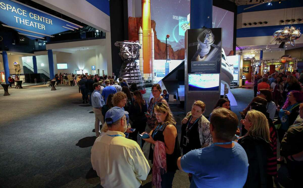 People wait to enter the Space Center Theater to hear Shannon Lucid, Rhea Seddon and Anna Fisher speak about their experience as three of the first six women recruited as astronauts by NASA at the Space Center Thursday, June 28, 2018, in Houston. The public event was held on the 35th anniversary of Sally Ride becoming NASA's first female astronaut in space.