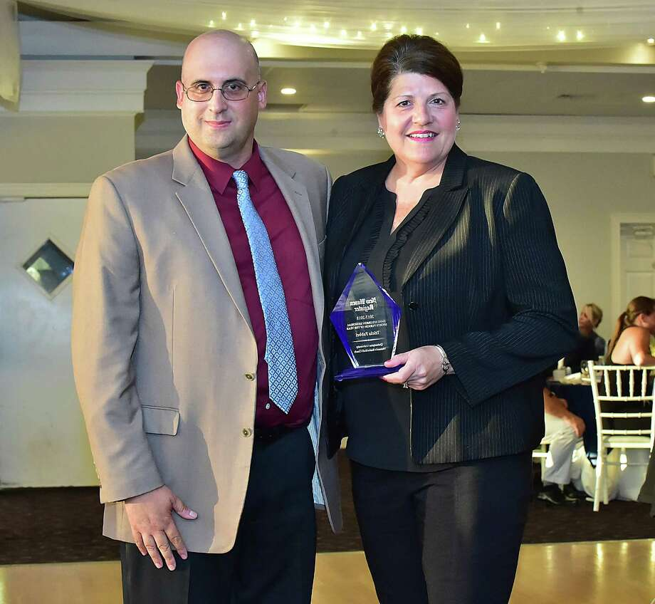 New Haven Register High Schools Editor Joe Morelli presents the 2017 Dave Soloman Memorial Sportsperson of the Year to Tricia Fabbri, Quinnipiac Women's Basketball Coach at the annual MVP banquet, June 28, 2018, at Amarante's Sea Cliff in New Haven. Photo: Catherine Avalone, Hearst Connecticut Media / New Haven Register