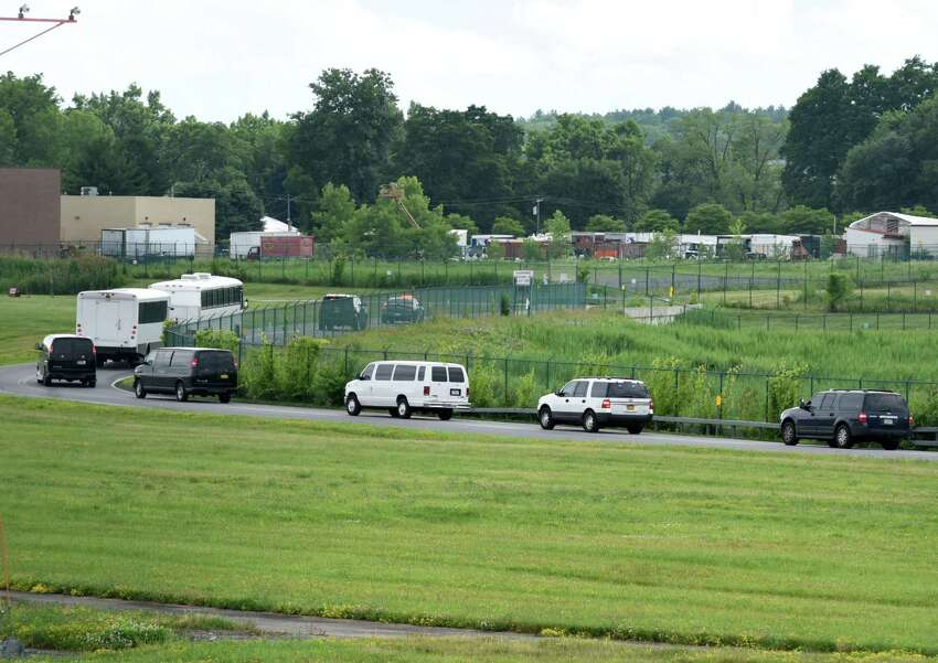 Immigrant men are escorted to Albany County Jail after landing at Albany International Airport on Thursday afternoon, June 28, 2018, in Colonie, N.Y. They were flown in from Arizona on a U.S. Immigration and Customs Enforcement jet. The jail has taken in 235 immigrant men who are being detained on immigration charges. (Will Waldron/Times Union)