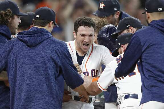 Houston Astros third baseman Alex Bregman (2) is mobbed by his teammates after hitting a two-run walk off home run to beat the Toronto Blue Jays 7-6 in the bottom of the ninth inning  at Minute Maid Park on Wednesday, June 27, 2018 in Houston. Astros won the game 7-6 with a two-run walk off home run.  (Elizabeth Conley/Houston Chronicle)