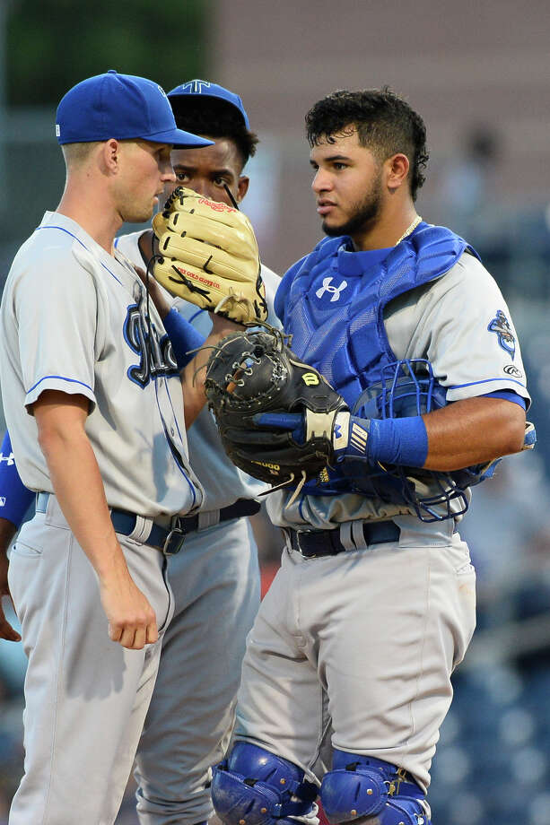 Tulsa catcher Keibert Ruiz (right) talks with relief pitcher Layne Somsen (left) during a pitching change against the RockHounds June 28, 2018, at Security Bank Ballpark. James Durbin/Reporter-Telegram Photo: James Durbin / ? 2018 Midland Reporter-Telegram. All Rights Reserved.