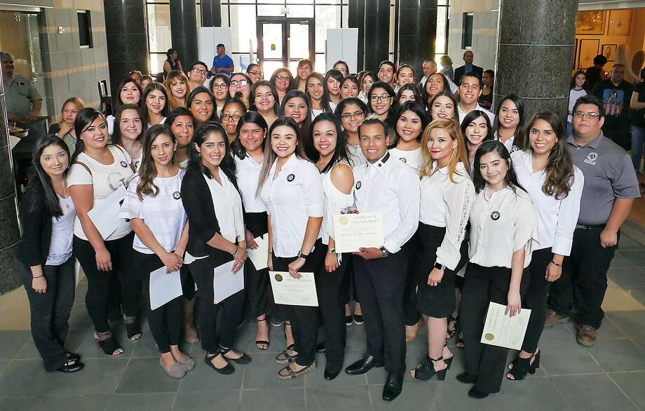 AmeriCorps members pose for a group photo following a ceremony Thursday at TAMIU celebrating their service and commitment this year serving as tutors with the TAMIU-LBV Literacy Partnership. Photo: Cuate Santos / Laredo Morning Times / Laredo Morning Times