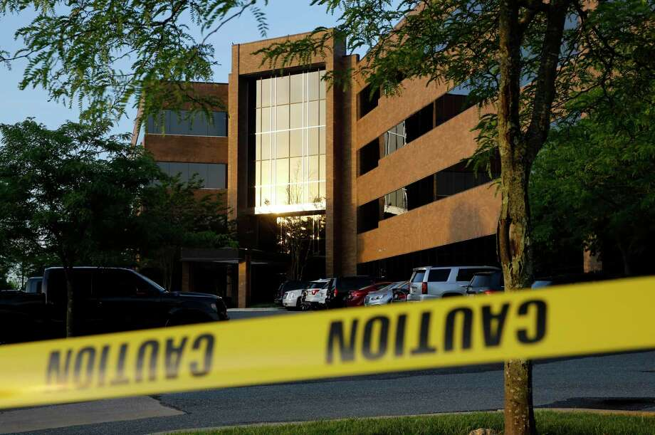 Crime scene tape surrounds a building housing The Capital Gazette newspaper's offices, Friday, June 29, 2018, in Annapolis, Md. A man armed with smoke grenades and a shotgun attacked journalists in the building Thursday, killing several people before police quickly stormed the building and arrested him, police and witnesses said. Photo: Patrick Semansky, AP / Copyright 2018 The Associated Press. All rights reserved.