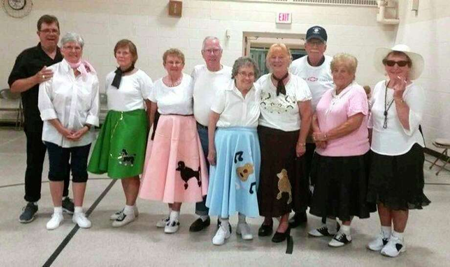 The Thumb Dance Club recently held its 50s Dance at the Maple Valley School. Sanilac County Senior Citizens and others enjoyed themselves dancing. Lighthouse Three led by Arnie Besonen kept the group lively and enthused with their love of music. Pictured are (from left): Rick and Linda Fey of Applegate; Shelby Combs of Sandusky; Dorothy Warner Echlin and Bill of Sandusky; Leola Rickett of Carsonville; Judy Varosi of Sandusky; band leader Arnie Besonen of Port Austin; Delores Pickard of Clyde; and Mary Ann Booth of Clyde. (Submitted Photo)