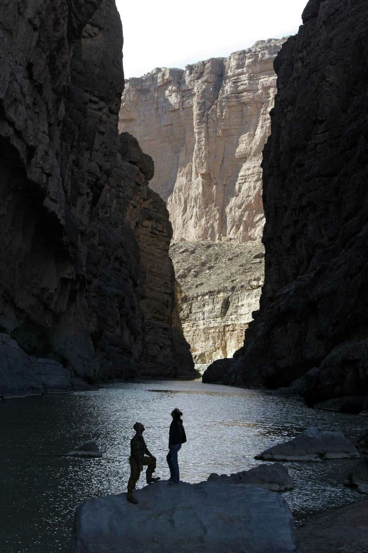 Kyle Crabtree and Cassidy McCaferry from Midland, Texas take in the majesty of the canyon walls as the Rio Grande River flows through Santa Elena Canyon in Big Bend National Park.