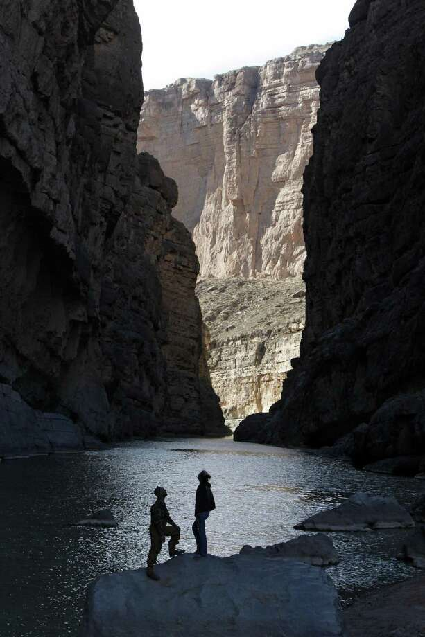 Kyle Crabtree and Cassidy McCaferry from Midland, Texas take in the majesty of the canyon walls as the Rio Grande River flows through Santa Elena Canyon in Big Bend National Park. Photo: Erich Schlegel, Contributor / For The Washington Post / 2011 The Washington Post