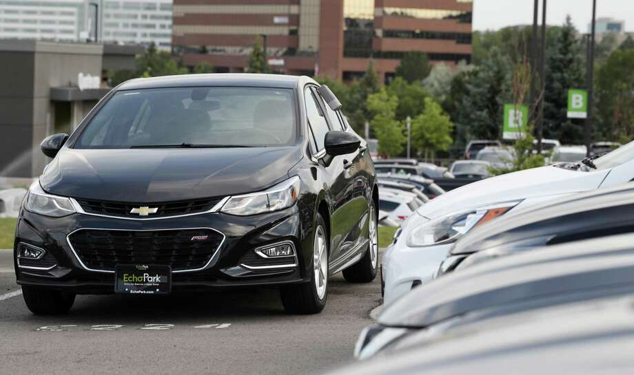 In this Tuesday, June 26, 2018, photograph, a used 2017 Chevrolet Cruze sits in a row of other used, late-model sedans at a dealership in Centennial, Colo. Prices of used small cars are on the rise after falling for the past five years. Photo: David Zalubowski /Associated Press / Copyright2018 The Associated Press. All rights reserved.