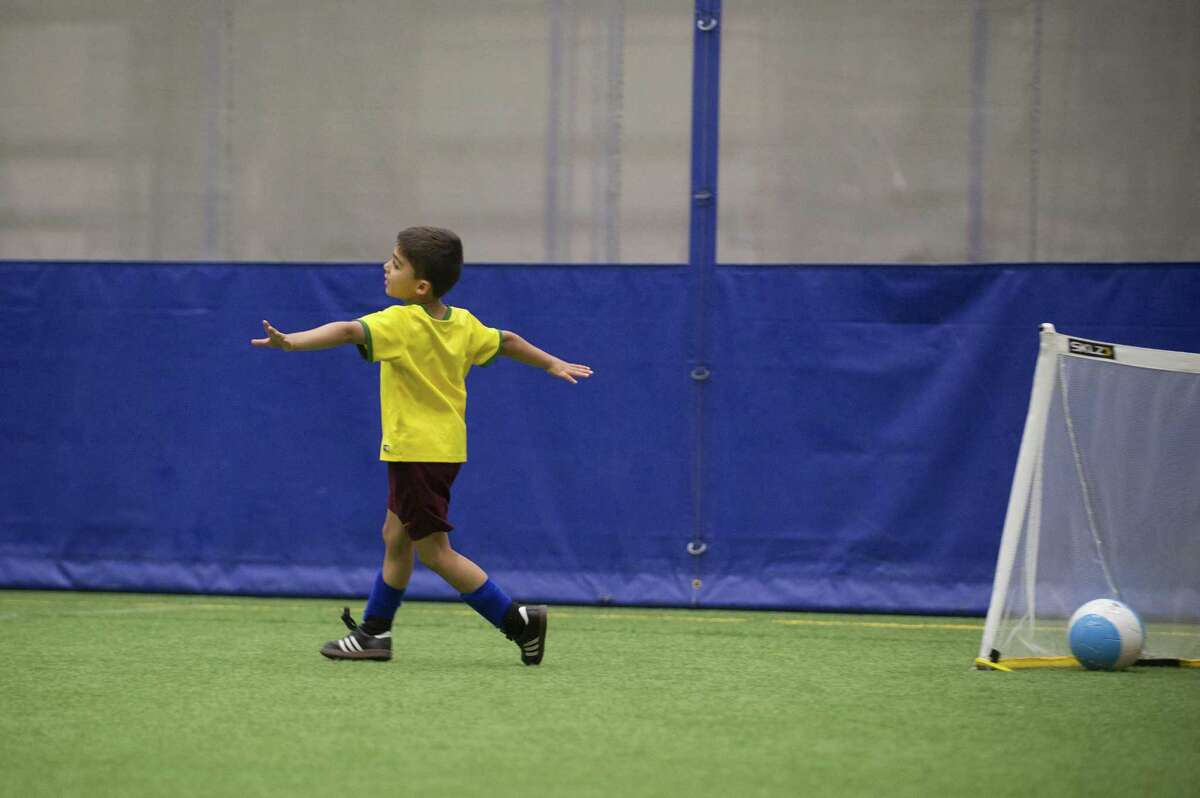 Six-year-old Caden Vasisht, of Darien, celebrates after scoring a goal in a 2v2 game during the World Cup themed soccer camp inside Chelsea Piers in Stamford, Conn. on Wednesday, June 27, 2018.