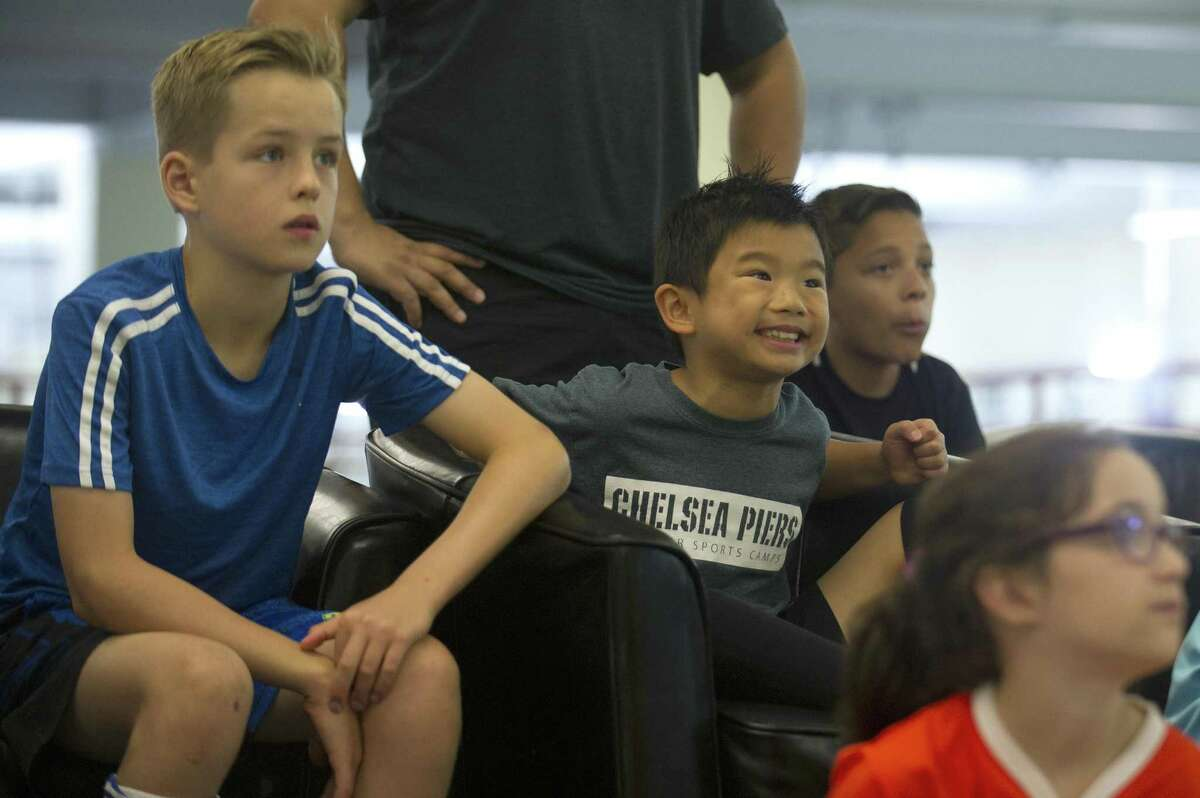 Eight-year-old Kendrick Fu, of Riverside, reacts while watching Germany play South Korea during the World Cup themed soccer camp inside Chelsea Piers in Stamford, Conn. on Wednesday, June 27, 2018. The kids watched parts of the matches while taking breaks from playing soccer.