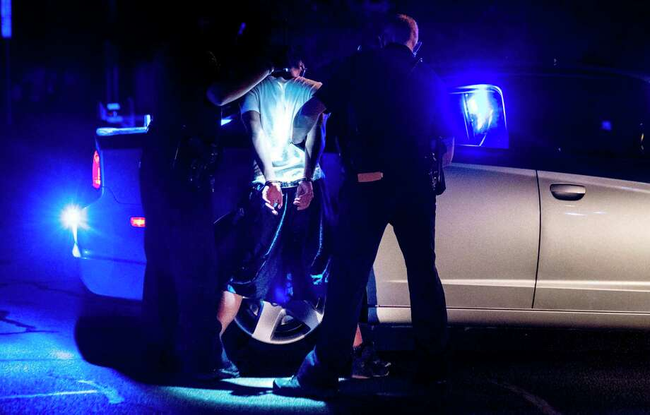 Northern Virginia Gang Task Force officers partner with ICE officers arrest an alleged MS-13 gang member in a Manassas, Va., neighborhood on August 10, 2017. Photo: Washington Post Photo By Melina Mara / The Washington Post