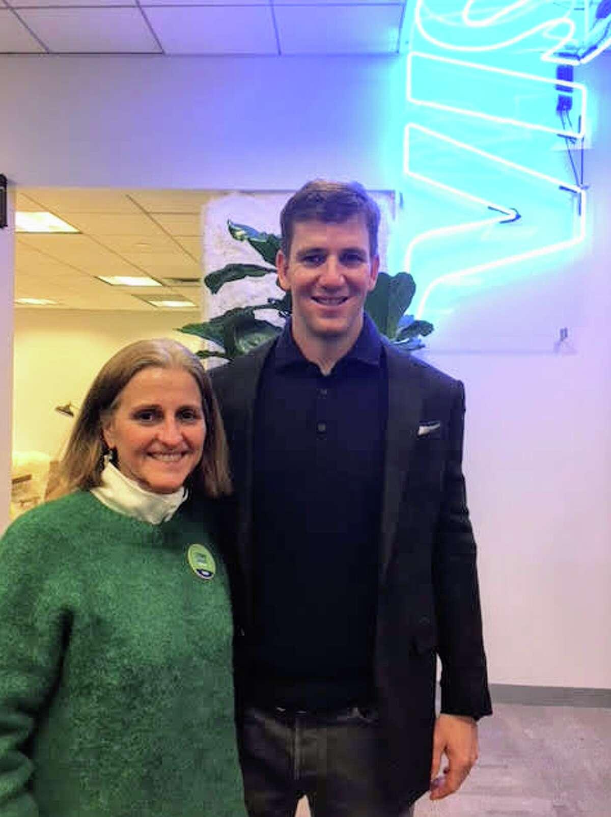 As part of Visa's sports sponsorhips, Biggar works with football stars like Eli Manning