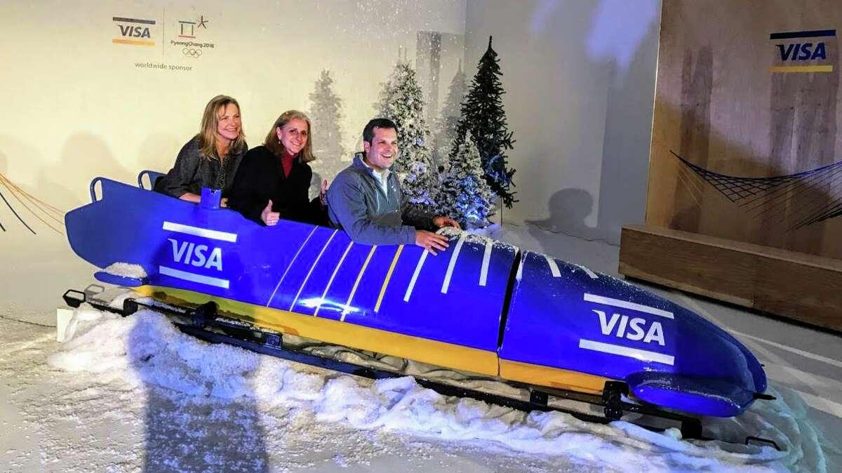 Lynne Biggar (center) in New York City celebrating Visa's sponsorship of the 2018 Olympic Winter Games