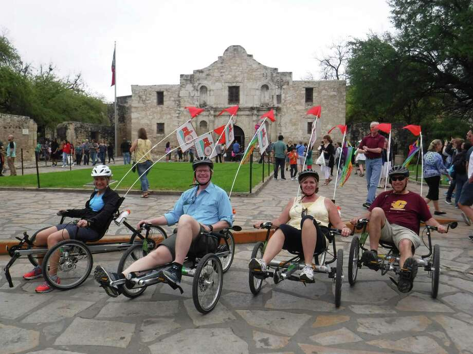 San Antonio Bike Tours won the 2018 Readers' Choice for Best Charters and Tours. Owner and chief guide Steve Wood (shown second from left) explains San Antonio's culture, art, history, architecture and food as he escorts riders around town on recumbent tricycles. Photo: Courtesy San Antonio Bike Tours