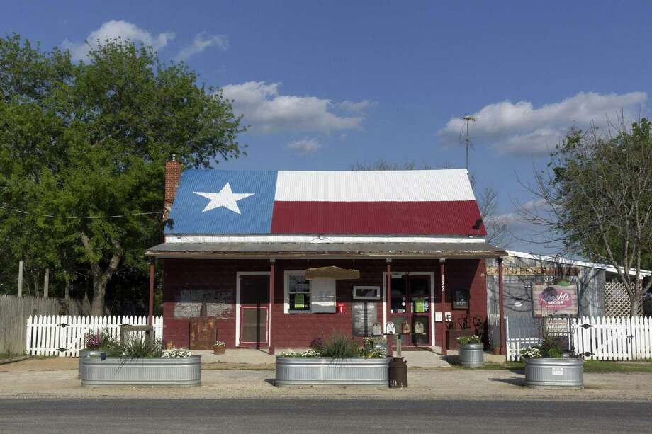 With its Texas flag tin roof, you can't miss Specht's Store at 112 Specht Road in San Antonio, which won the 2018 Reader's Choice Award winner for kid-friendly dining. Photo: Ray Whitehouse /For The Express-News