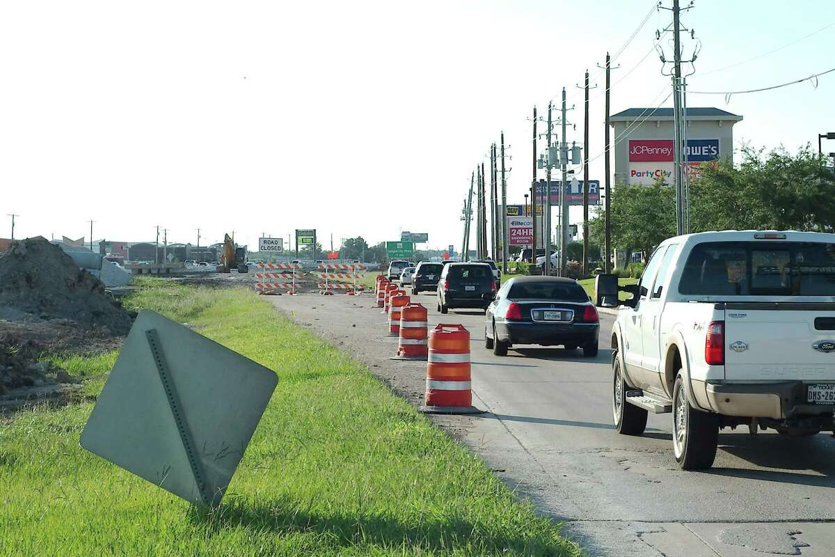 Northbound traffic backs upon a recent morning on the Interstate 45 feeder road between FM 646 and FM 518 in League City. Work related to widening the interstate is causing headaches for commuters.