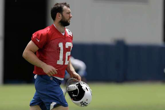 Indianapolis Colts quarterback Andrew Luck (12) runs during practice at the NFL football team's training camp, Wednesday, June 13, 2018, in Indianapolis. (AP Photo/Darron Cummings)