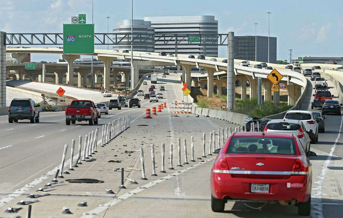 Motorists merge onto the westbound U.S. 290 ramp while traveling on northbound on Loop 610 on June 26.