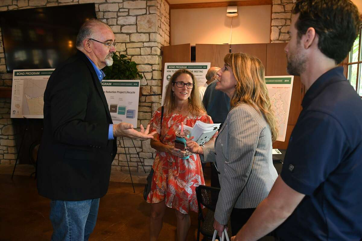 Harris County Commissioner R. Jack Cagle of Precinct 4, from left, talks with Heather Washburn, District Director for Congressman Kevin Brady, and Marlisa Briggs, Executive Director of North Houston Association, during the Harris County Flood Control District Bond Program Information & Community Engagement meeting at the Big Stone Lodge At Dennis Johnston Park in Spring on June 27, 2018. (Jerry Baker/For the Chronicle)