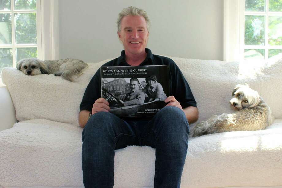 """Richard """"Deej"""" Webb sits in his Westport home with his two dogs, Zelda and Daisy, on June 18. Webb's book, """"Boats Against the Current: the Honeymoon Summer of Scott and Zelda: Westport, Connecticut 1920,"""" will be released on Amazon on Tuesday. Photo: Sophie Vaughan / Hearst Connecticut Media / Westport News"""
