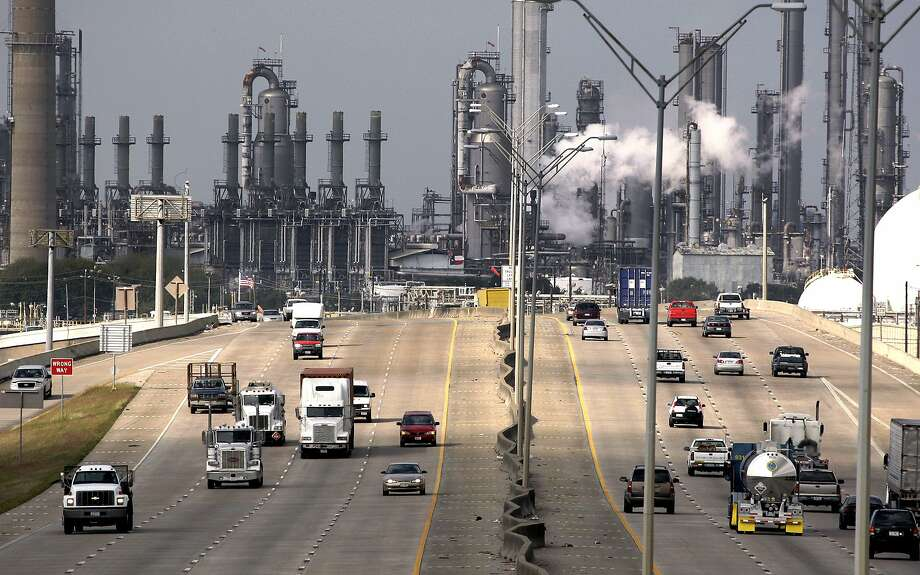 FILE -  In this Nov. 21, 2007 file photo, Shell Oil Company's Deer Park refinery and petrochemical facility is shown in the background as vehicles travel along Highway 225 in Deer Park, Texas.  Photo: David J. Phillip, AP