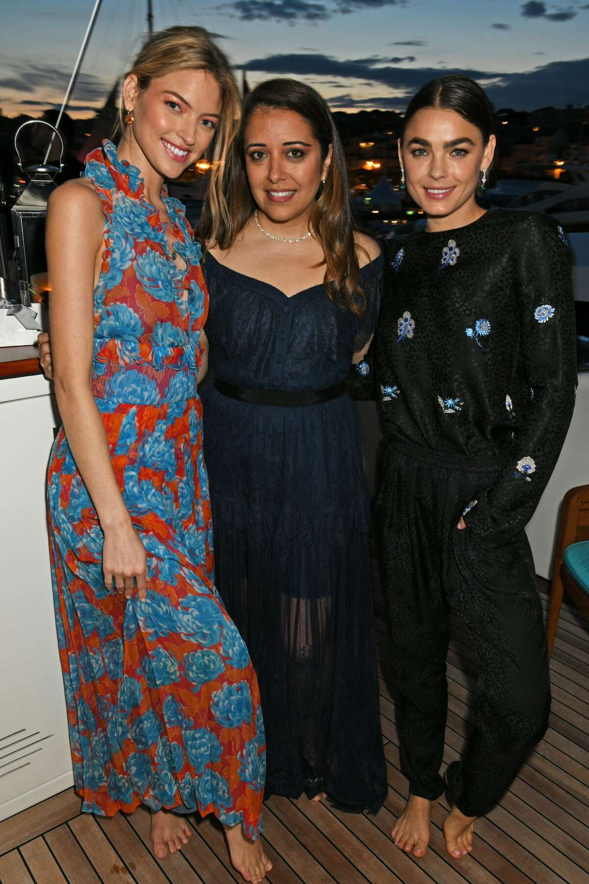 (L to R) Martha Hunt, Laura Chavez and Bambi Northwood-Blyth, wearing Lark and Berry, attend the Lark and Berry launch party on a private yacht during the 71st Cannes Film Festival on May 16, 2018 in Cannes, France.