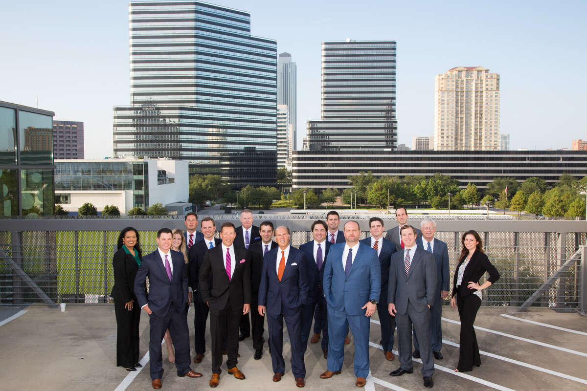The Houston team of Jackson Cooksey. Neal Golden, NKF president, Texas Region, and Jim Cooksey, who will serve as NKF's vice chairman and president of tenant representation Texas, are on the front row, 2nd and 3rd to the right.