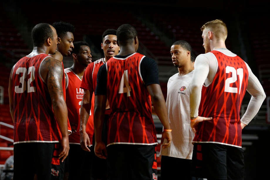 Lamar men's basketball assistant coach Justin Bailey talks with the players during practice on Thursday. 