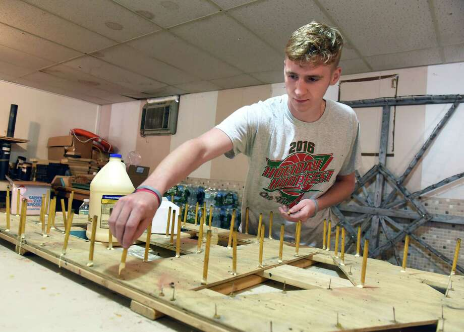 Employee Bradley McGreevy glues yellow lances into a Market 32 display board at Santore's World Famous Fireworks as they prepare for the 4th of July on Friday, June 29, 2018 in Schaghticoke, N.Y. (Lori Van Buren/Times Union) Photo: Lori Van Buren, Albany Times Union / 20044200A