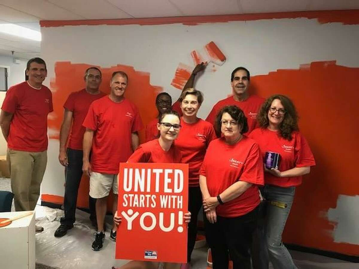Liberty Bank employees volunteered their efforts to paint the Middlesex United Way office in Middletown.