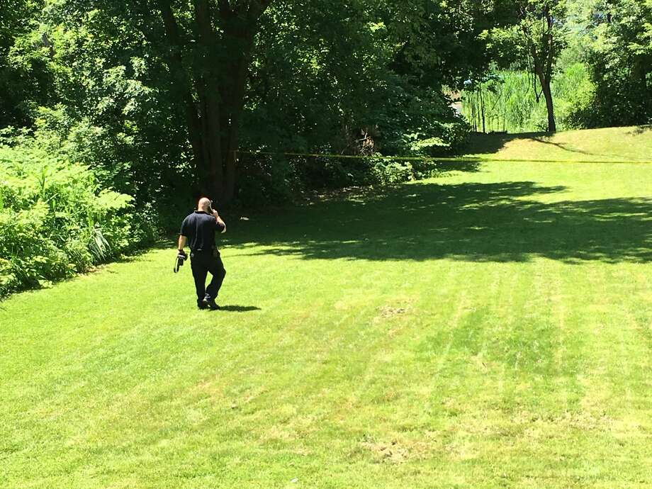 Schenectady police were investigating the discovery Friday of a body along Cucumber Alley. Photo: Paul Nelson / Times Union