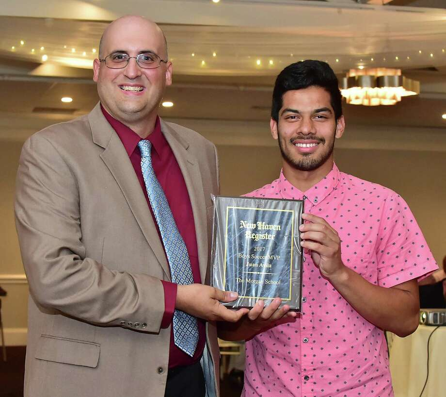 Joe Morelli presents the Soccer MVP award to Juan Avila of the Morgan-Clinton School at the New Haven Register's annual MVP banquet, June 28, 2018, at Amarante's Sea Cliff in New Haven. Photo: Catherine Avalone / Hearst Connecticut Media / New Haven Register