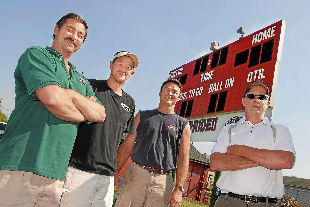 In 2012, the scoreboard at Pierson Park in Cromwell was refurbished by, from left, Michael Slifer, Brian Slifer, Kevin Slifer and Brent Robbins.